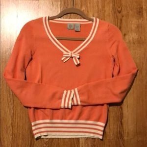 Cute orange sweater with bow detail